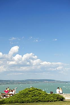 People enjoying the view of Lake Balaton from Tihany, Hungary, Europe