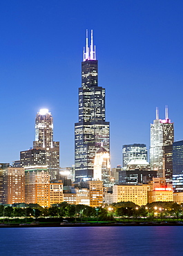 Dusk view of the city skyline including the 110-storey Willis Tower, formerly known as the Sears Tower, Chicago, Illinois, United States of America, North America