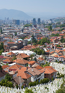 View across the Martyrs Memorial Cemetery in the foreground, of Sarajevo, capital of Bosnia and Herzegovina, Europe