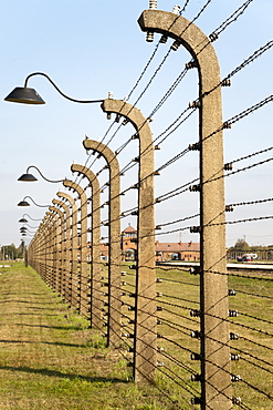 Electrified barbed-wire fencing and buildings at the museum of the former Auschwitz II-Birkenau concentration camp, UNESCO World Heritage Site, Poland, Europe