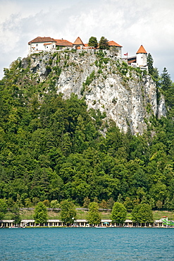 Bled Castle on a rocky promontory overlooking Lake Bled in the Julian Alps in northwest Slovenia, Europe