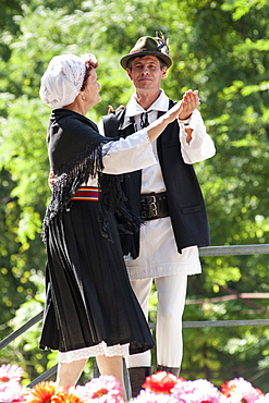 A couple in traditional costume dancing for Limba Noastra (National Language Day) on 31st August, Chisinau, the capital of Moldova, Europe