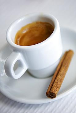 Cup of espresso and a cinnamon stick in a Portuguese cafe.