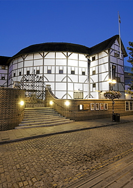 Dusk view of Shakespeare's Globe theatre on the banks of the Thames river in London.
