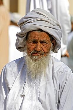 Omani man at the Friday market in Nizwa in Oman.