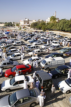 Second-hand vehicles for sale at the Friday souk in Nizwa in Oman.
