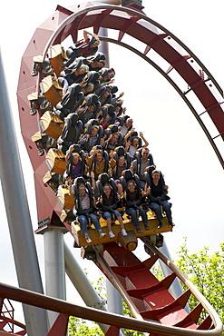 People riding a roller-coaster, Tivoli Gardens Amusement Park, Copenhagen, Denmark, Scandinavia, Europe