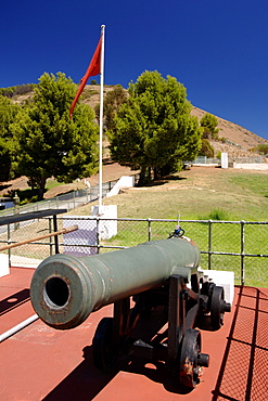 View of one of the two noon guns at Lion Battery on Signal Hill in Cape Town. The daily noon gun is Cape Town's oldest living tradition and the two cannons used are the oldest guns in daily use in the world. They have marked the midday hour in the mother city in this distinctive, albeit noisy manner since early 1806. The cannons were cast in Britain in 1794 and still bear the royal crest of King George the third. The firing of the cannon was originally to give ships in the bay a means of re-setting their clocks accurately.