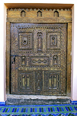 A carved door to a room in the Palais Sebban riad in Marrakech, Morocco