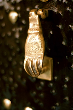A 'hand of Fatima' door knocker on a door in the medina in Marrakech, Morocco