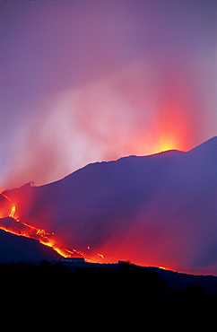 Lava flow from the Piano del Lago cone destroying the cable car above Rifugio Sapienza on the south flank of Mount Etna during the 2001 eruptions, Sicily, Italy, Europe