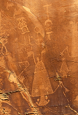 Petroglyphs carved 1000 years ago by Fremont Native American people in the iron oxide 'desert varnish' on the sandstone of Cub Creek Valley in this fossil park, Dinosaur National Monument, Utah, United States of America (USA), North America