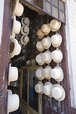 Shop of Alberto Pulla, the famous hatter on Calle Larga, where paja toquilla, misnamed panama hats, are sold and repaired with white sulphur paint, Cuenca, Azuay Province, Southern Highlands, Ecuador, South America