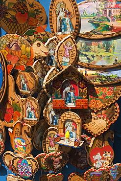 Catholic ornaments outside Basilica de Nuestra Senora de Agua Santa (the Virgin of the Holy Water) which is famous for miracles, on the Parque de la Basilica, Banos, Ambato Province, Central Highlands, Ecuador, South America