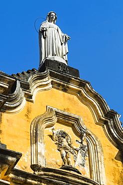 Statue atop the baroque facade of the Iglesia de la Recoleccion church, built 1786, in this historic northwest city, Leon, Nicaragua, Central America