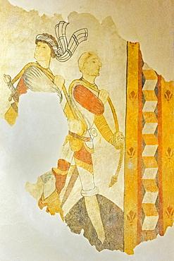 A 15th century fresco of armed men in St. Eutrope church in the historic village on the River Dropt, Allemans-du-Dropt, Lot-et-Garonne, France, Europe