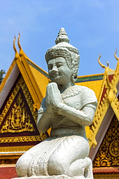 Kneeling Buddhist statue at the Mondapa of Satra and Triptika Library in the Royal Palace, City Centre, Phnom Penh, Cambodia, Indochina, Southeast Asia, Asia