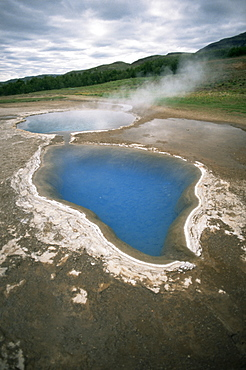 Hot water pools in this area of geothermal activity, Geysir, Iceland, Polar Regions