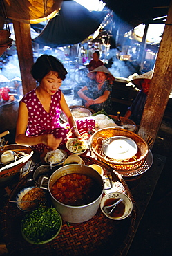 Woman preparing food at a stall in the market, Hoi An, Vietnam, Indochina, Southeast Asia, Asia