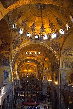 Interior of St. Mark's Basilica (Basilica di San Marco) with golden Byzantine mosaics illuminated, Venice, UNESCO World Heritage Site, Veneto, Italy, Europe