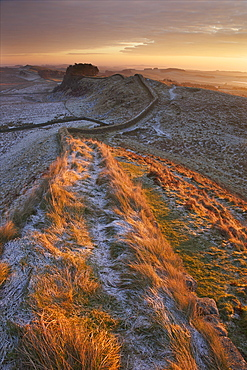 Sunrise on Hadrian's Wall National Trail in winter, looking to Housesteads Fort, Hadrian's Wall, UNESCO World Heritage Site, Northumberland, England, United Kingdom, Europe