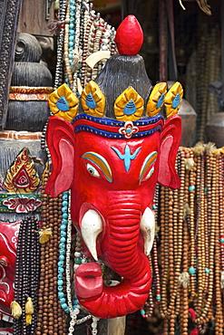 Mask of Ganesha, a Hindu god, on sale at Swayambhunath Stupa (Monkey Temple), Kathmandu, Nepal, Asia