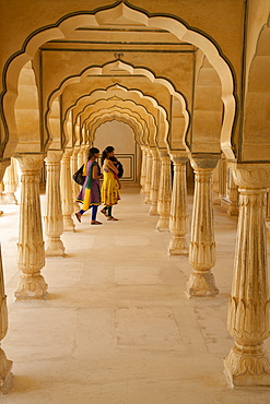 Indian women under arches, Amber Fort Palace, Jaipur, Rajasthan, India, Asia