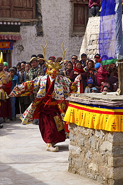 Buddhist monk performs masked dance at religious ceremony, Namgyal Tsemo Gompa, Leh, Ladakh, India, Asia