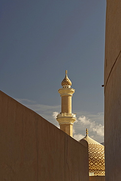Minaret and dome of the Sultan Quaboos Mosque as seen from the fort, Nizwa, Oman, Middle East