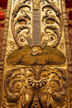 Baroque ornamentation with skull, artful embroidery on a chasuble, historical liturgical garment, Stiftsmuseum Museum Xanten monastery museum, Xanten, Niederrhein region, North Rhine-Westphalia, Germany, Europe