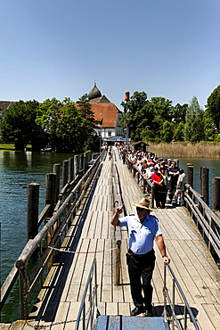 Tourists on the Fraueninsel pier waiting to board a ferry, lake Chiemsee, Chiemgau, Upper Bavaria, Germany, Europe
