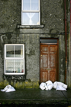 Sand bags, house front, City of Galway, Republic of Ireland, Europe