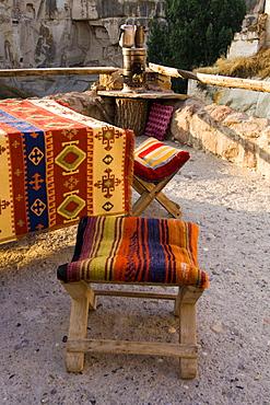Turkish chairs and fireplace for boiling tea on a balcony, Ortahisar, Cappadocia, Anatolia, Turkey, Asia