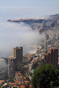 Principality of Monaco with fog over the sea, Cote d'Azur, Mediterranean Sea, Europe