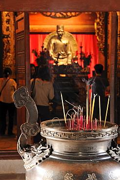 Incense sticks in front of the statue of Chu Van An, Temple of Literature, Van Mieu, Hanoi, Vietnam, Southeast Asia