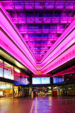 Neon-lit entrance hall of the train station in Zug, Switzerland, Europe