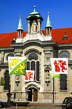 Flags with the coat of arms of the canton of Thurgau and the Frauenfeld village in front of the Catholic church of St Nikolaus, Frauenfeld, Canton Thurgau, Switzerland, Europe