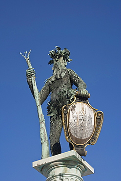 Bronze statue from the Neptune Fountain, a wild man bearing a trident and the coat of arms of Salzburg, Max-Reinhardt-Platz square, a UNESCO World Heritage Site, Salzburg, Austria, Europe
