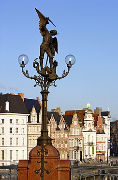 Dragonslayer, sculpture on the Sint Michielsbrug, houses on the river Lys, old town, Ghent, East Flanders, Belgium, Europe