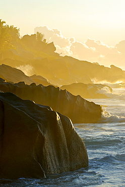 Morning light on the beach with granite cliffs, La Digue, Seychelles, Africa
