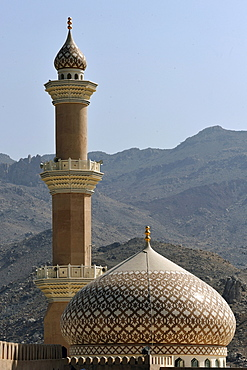 View from the fort on the minaret and dome of the mosque in Nizwa, Oman, Middle East