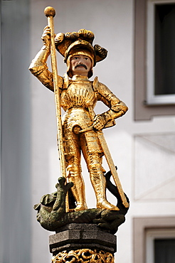 St. George and the dragon, golden fountain statue on Muensterplatz cathedral square, Freiburg im Breisgau, Baden-Wuerttemberg, Germany, Europe