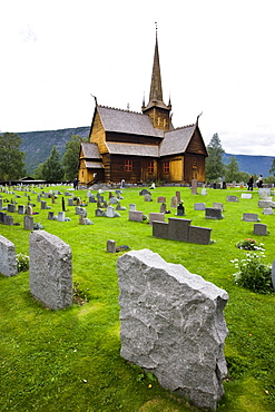 Grave stones in front of Lom Stave Church, Norway, Scandinavia, Europe