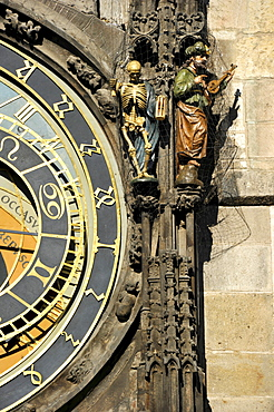 Allegorical statues representing death and paganism on the Prague Astronomical Clock on the clock tower of the Old Town City Hall, Old Town Square, historic district, Prague, Bohemia, Czech Republic, Europe