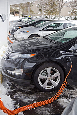 Chevrolet Volt electric cars charging outside the General Motors Detroit-Hamtramck Assembly Plant, where the Volt is manufactured, Detroit, Michigan, USA