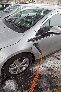 A Chevrolet Volt electric car charging outside the General Motors Detroit-Hamtramck Assembly Plant, where the Volt is manufactured, Detroit, Michigan, USA