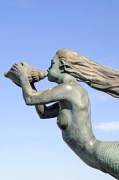 Sculpture of a mermaid blowing a chonch shell, La Magdalena peninsula, Santander, Cantabria, Spain, Europe