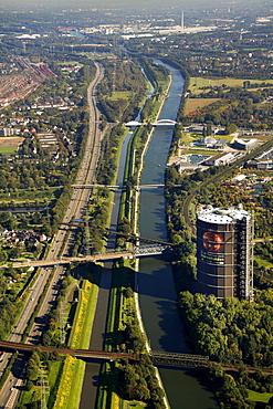 Aerial view, Rhine?Herne Canal with gasometer, Emscher river, Neue Mitte, Oberhausen, Ruhrgebiet region, North Rhine-Westphalia, Germany, Europe