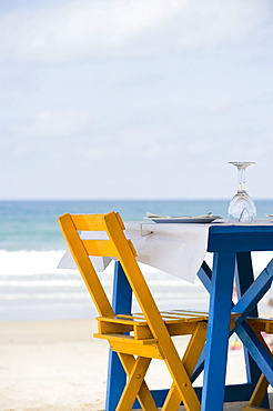 Well laid blue table with yellow chairs on the beach, Conil de la Frontera, Costa del Luz, Andalucia, Spain, Europe