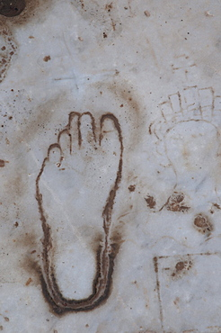 Footprint in stone, ancient archaeological excavation site of Ephesus, Selcuk, Lycia, Turkey, Asia